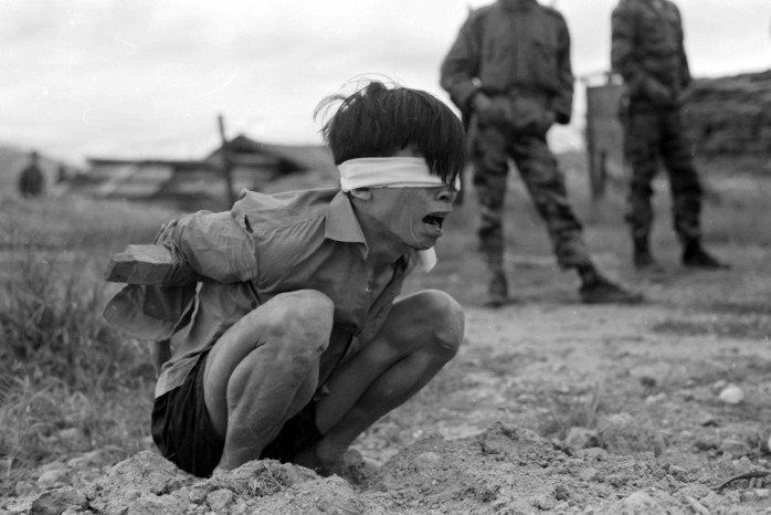 vietcong-prisoner-captured-by-the-us-army-awaits-interrogation-during-vietnam-war